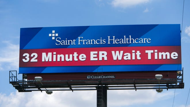A billboard along northbound I-95 near exit 6 in Wilmington of Saint Francis Healthcare promoting their 32-minute ER wait time. The hospital has recently been named a Level III Trauma Center.