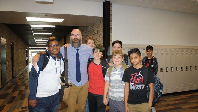"Kevin Ozar, Farmington STEAM Academy teacher, won the prestigious Michigan Council of Teachers of English ""Ray H. Lawson Award."""