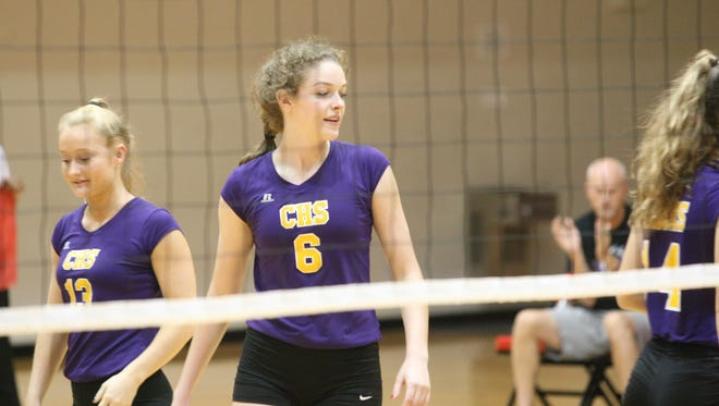 Clarksville's Sadie Walker (6) and her teammates get ready to play during the Region 7-AAA volleyball tournament against Arlington on Monday night at Rossview High School.