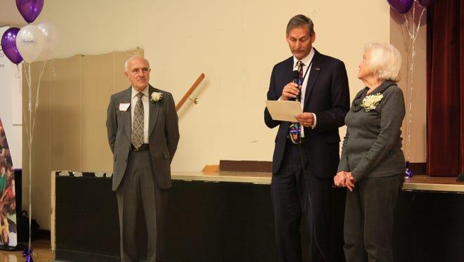 Farmington Public Schools Superintendent George Heitsch (center) presents Senior Adult Extraordinaire awards to John Weigel and Betty Bemis.