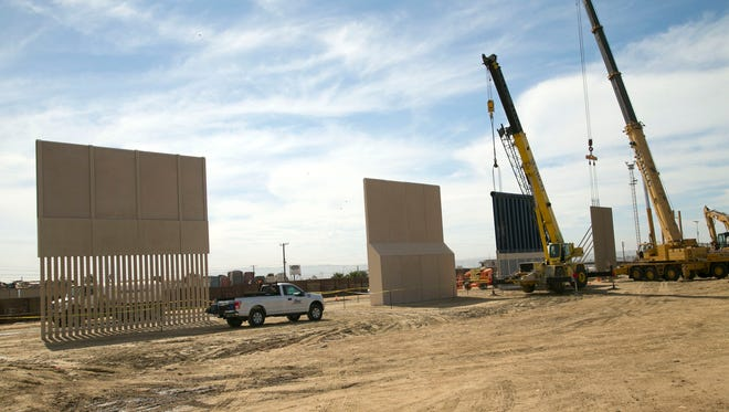 Construction of the border wall prototypes continues near the Otay Mesa Port of Entry outside of San Diego, Calif., on October 17, 2017.