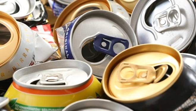 """Cans for Cash"" trades money for aluminum cans on Nov. 11."