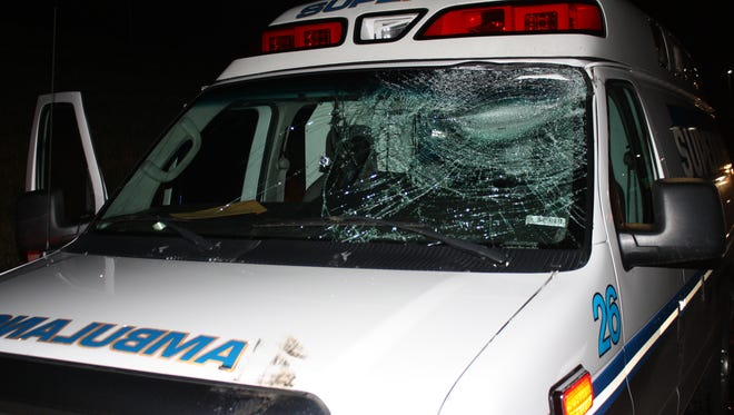 Ambulance damaged after blown tire causes crash with police car