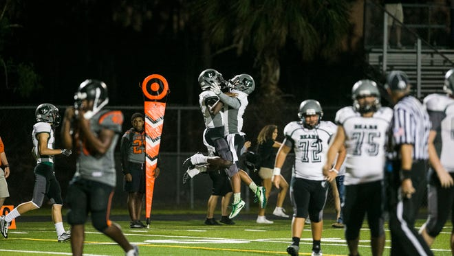 Palmetto Ridge celebrates a touchdown after scoring against Lely during the game at Lely High School on Friday, Nov. 3, 2017.