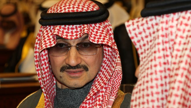 "FILE- In this March 7, 2010 file photo, Saudi billionaire Prince Alwaleed bin Talal al-Saud attends the speech of King Abdullah bin Abdul Aziz al-Saud of Saudi Arabia, at the Saudi Shura ""consultative"" council in Riyadh, Saudi Arabia.  Saudi Arabia has arrested dozens of princes and former government ministers, including a well-known billionaire with extensive holdings in Western companies, as part of a sweeping anti-corruption probe, further cementing King Salman and his crown prince son's control of the kingdom. A high-level employee at Prince Alwaleed bin Talal's Kingdom Holding Company told The Associated Press that the royal was among those detained overnight Saturday, Nov. 4, 2017."