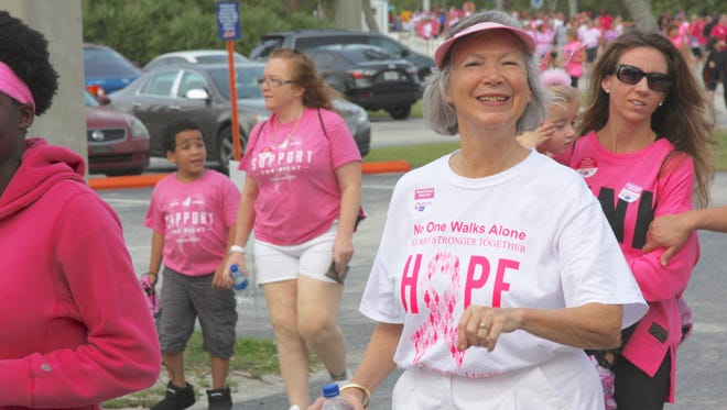Port St. Lucie Business Women team member Carol Wyatt, foreground, proudly wears her team t-shirt as she walks in the Making Strides Against Breast Cancer walk Oct. 28 at First Data Field.