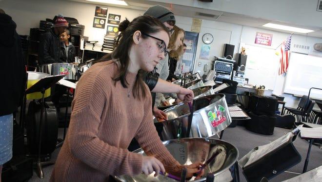 Jeannie Sebesta plays a lead pan in the Binghamton High School Juice Blenders Steel Drum Band during a Nov. 30 rehearsal.