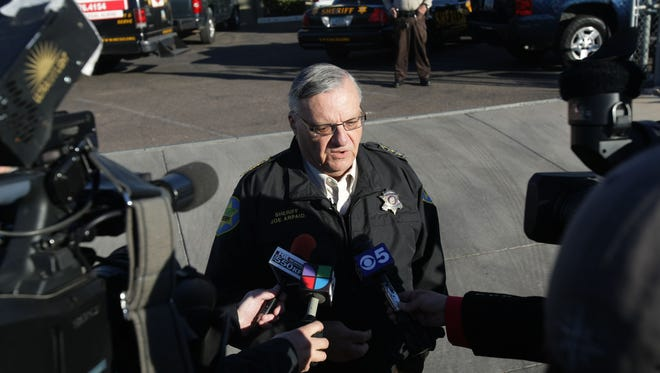 Maricopa County Sheriff Joe Arpaio talks to the media during an immigration raid at Great Western Erectors in Phoenix on Feb. 3, 2011.