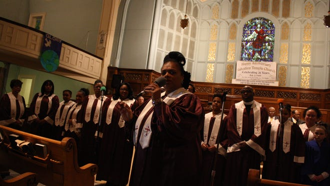 Portia Barnett, Director of the House of Worship Church Community Choir, speaks prior to the choir's performance at the Dr. Martin Luther King, Jr. Memorial Celebration & Service.
