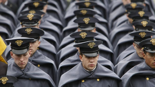 The U.S. Military Academy Cadets march off the field before the start of the 113th Army-Navy game at Lincoln Financial Field in Philadelphia, VA on Saturday, December 8, 2012.