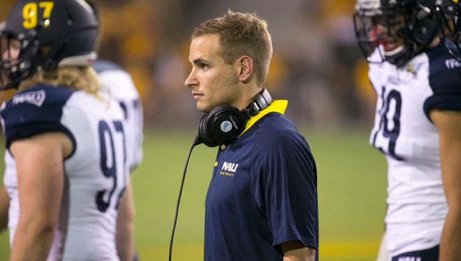 NAU wide receivers coach Aaron Pflugrad looks on during a 2016 game against ASU at Sun Devil Stadium.