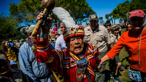 Honored Seminole Elder Bobby Henry leads a friendship