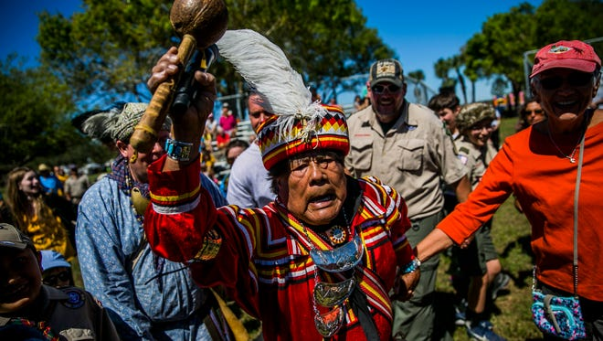 Honored Seminole Elder Bobby Henry leads a friendship dance following the Seminole Reenactment in Immokalee on Saturday, March 3, 2018.
