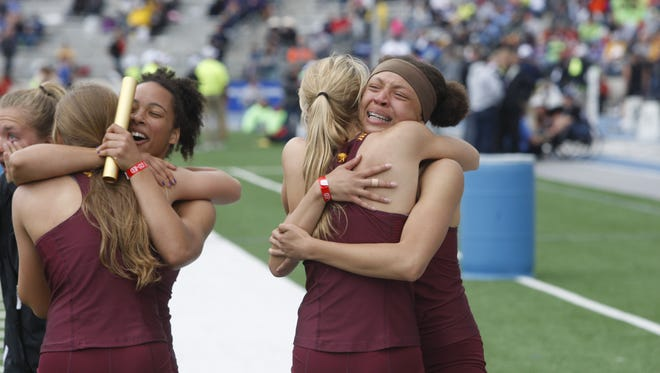 Members of the Ankeny 4x100 relay team celebrate their second-place finish in the 2017 Class 4A state meet on at Drake Stadium. The 4x100 squad finished third at state last year and looks to be strong event for the Hawkettes in 2019.