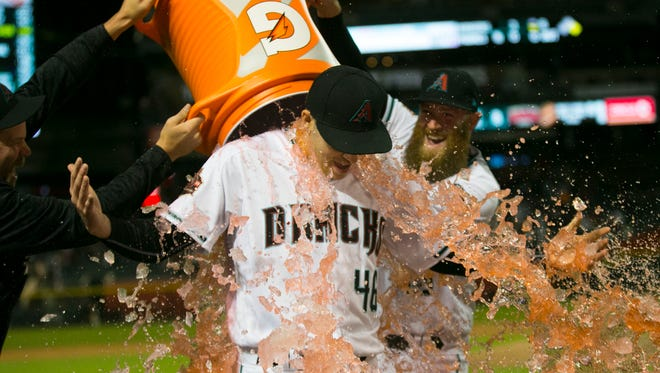 Diamondbacks pitcher Patrick Corbin is dunked with Gatorade by pitcher Archie Bradley after getting the shutout against the Giants at Chase Field in Phoenix on April 17, 2018.