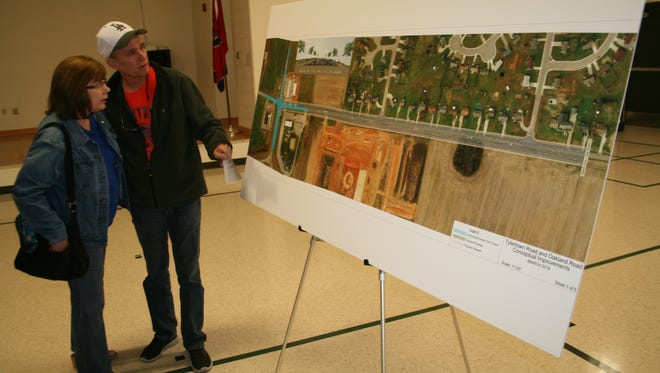 Residents look over plans for the Tylertown Road/Oakland Road widening project.