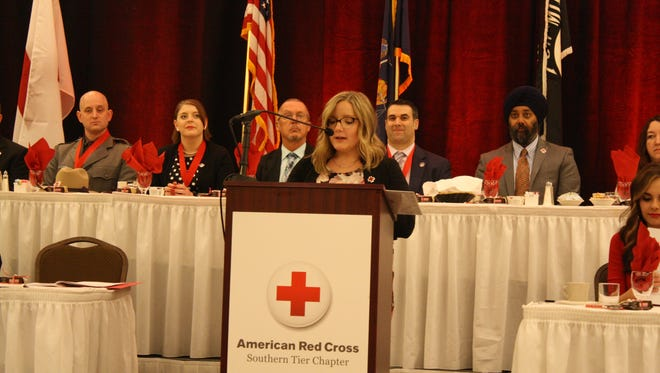 Southern Tier Chapter Executive Director Colleen McCabe speaks at the Ninth Annual Real Heroes Breakfast at the DoubleTree by Hilton Binghamton Thursday morning.