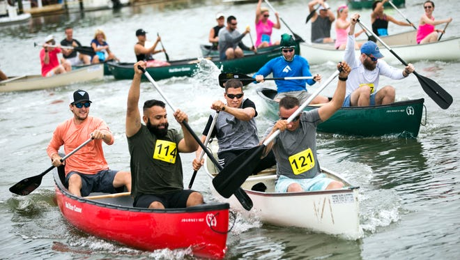 Paddlers battle to pull ahead from the starting line in the 'Ambitious Amateurs' race during the 42nd Annual Great Dock Canoe Race on Saturday, May 12, 2018 at Crayton Cove. The theme for the race this year was 'Reel or FantaSea'.