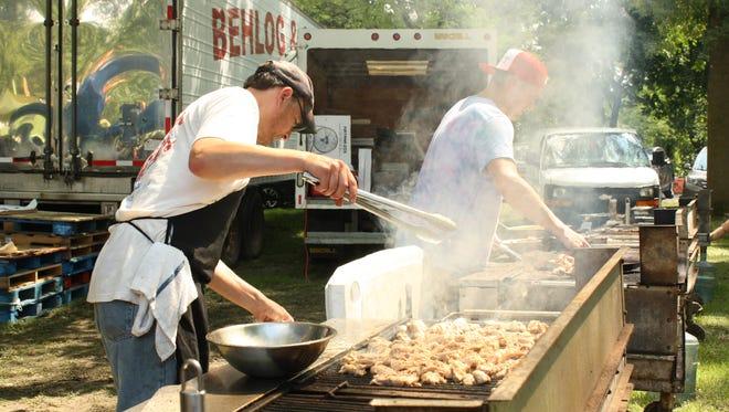 Don Petrid and Brandon Sullivan cook spiedies for Salamida's spiedies Saturday.