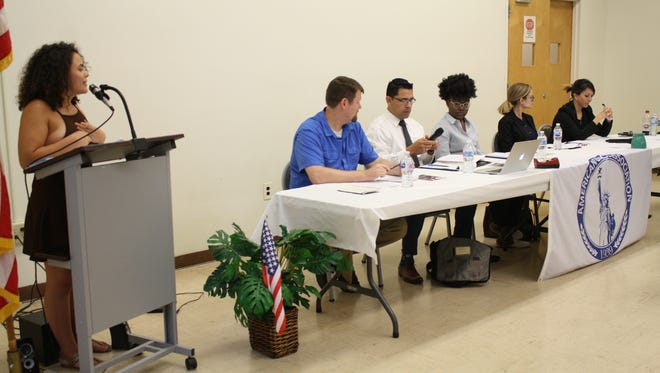 Kalissa Nancy Sawyer moderates a panel of five experts during Tuesday evenings' Immigration Panel at the American Civic Assocation.