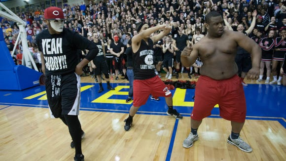 L-R North Central fans Lorrell Williams, 18, Hector Carmona, 17, and Wesley Snipes, 18, dance at half time during Carmel's 58-38 sectional win at Carmel High School, March 2, 2013. D. Kevin Elliott / For The Star