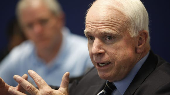 Sen. John McCain (in an August photo) said Tuesday: Our enemies act without conscience. We must not.""