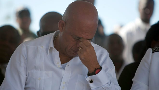 Haiti's President Michel Martelly attends a memorial service for victims of the January 2010 earthquake, at Titanyen, a mass burial site north of Port-au-Prince, Haiti, Monday, Jan. 12, 2015.