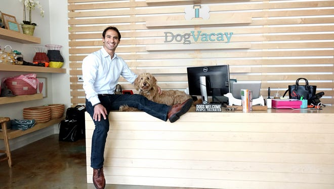 Aaron Hirschhorn, CEO of DogVacay, an Airbnb-like network of dog sitters, posing with his dog, Rocky.