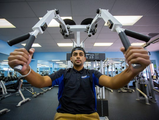 G3 Fitness employee Emmanuel Gutierrez works out at
