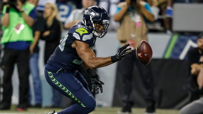 Did K.J. Wright intentionally knock the ball of bounds?