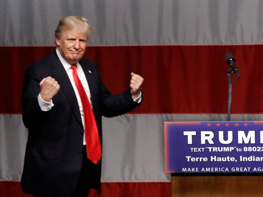 Donald Trump reacts to a song during a campaign rally