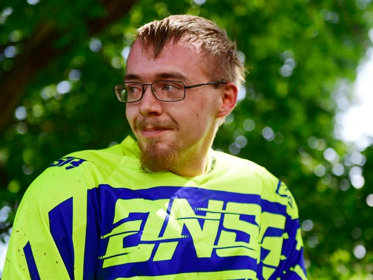 Mark Frahn sits on a four-wheeler after he finished riding a dirt bike for the first time since his accident in the backyard of his Codorus Township home on May 11, 2018. On June 11, 2017, Frahn fractured his L1 vertebrae after crashing his dirt bike. Doctors told him he wouldn't be able to walk again.
