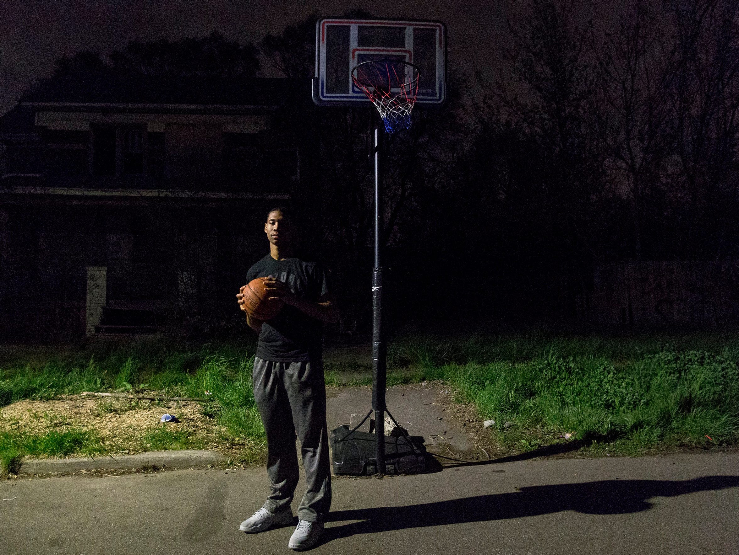 Michael Green stands under the same basketball hoop