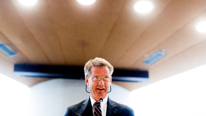 Knox County Mayor Tim Burchett congratulates the new citizens during a U.S. Naturalization Ceremony at the City County Building in Knoxville, Tennessee on Tuesday, July 24, 2018.