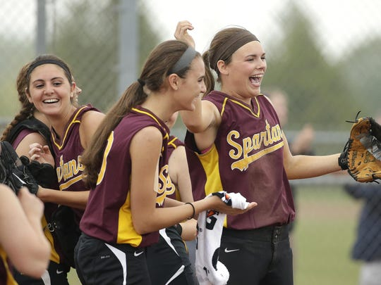 Luxemburg-Casco players celebrate after defeated Shawano in Friday's WIAA Division 2 regional final softball game in Luxemburg.
