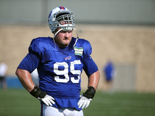 Veteran defensive lineman Kyle Williams between drills