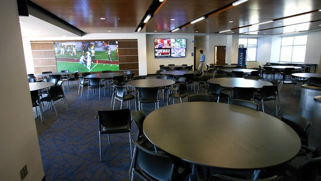 The new UK football recruiting room at Commonwealth Stadium has multiple televisions.Sept. 24, 2015