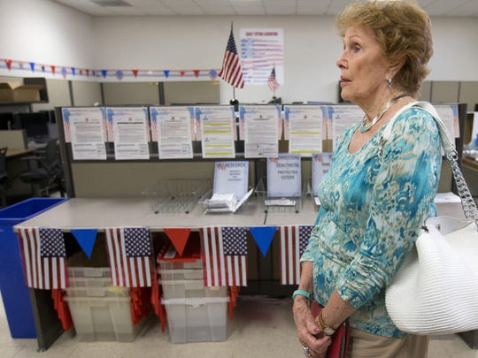 Helen Purcell walks through the Maricopa County Tabulation
