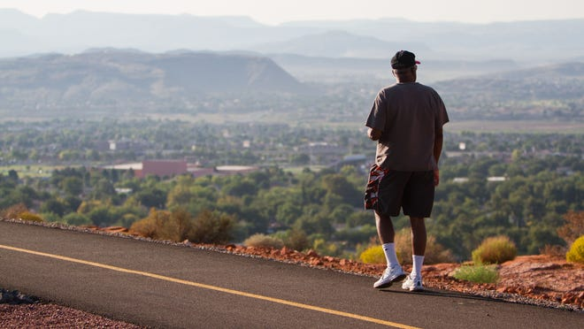 Ray Johnson admires the view from the Sugarloaf Rim Trail on Red Hills Parkway in this file photo. The St. George City Council is considering a series of items in its meeting Thursday that could add new additions to the city's trail system.