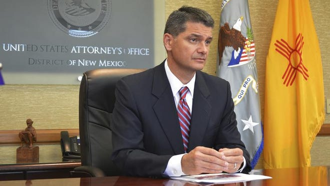 In this Aug. 9, 2016, photo, U.S. Attorney Damon Martinez speaks to reporters from his desk in Albuquerque, New Mexico. Martinez and the U.S. Justice Department announced an agreement with the University of New Mexico on Monday, Oct. 17, to improve how the school responds to student complaints of sexual assault and harassment.
