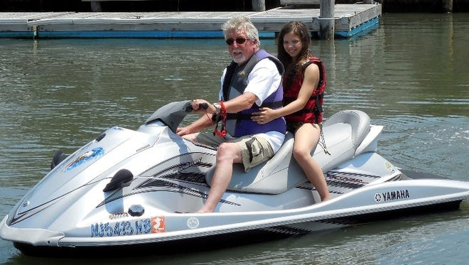 Tom Graham of Stone Harbor rides his waverunner with granddaughter Kyley.
