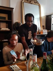 Tunde Wey serves his family's traditional Nigerian recipes at his From Lagos pop-up dinner in Detroit on April 9, 2016, which focused on the topic of blackness in America.