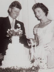 Jacqueline Bouvier Kennedy and John F. Kennedy cut the cake at their wedding on Sept. 12, 1953.
