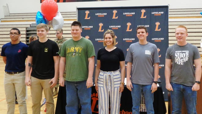 Loveland High School seniors participating in the school's debut Armed Forces Signing Day included Gabe Thomas, Marine Corps; Austin Montgomery, Army; Cody Smith, JROTC; Kady Huesman, Navy; Brad Williams, National Guard; and William Rupe, National Guard. Not pictured are Ben Brynjulfson-Rearon, Air Force; Mallory Beam, Army; Austin Crisafi, Army; Adam Turner, Marine Corps; Audrey Swearingen, National Guard; and Liam Smith, Army ROTC.