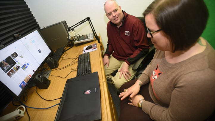 NMSU business professor and Sheriff Chair for Entrepreneurship Robert Macy, left, works with Lauren Goldstein in a recording studio used for web and podcasting at the Arrowhead Center on campus on Feb. 29, 2016.