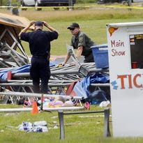 Investigators on the scene Tuesday of a circus tent collapse in Lancaster, N.H.