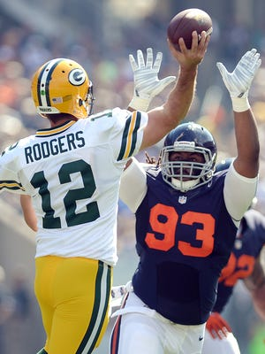 Green Bay Packers quarterback Aaron Rodgers (12) throws over the arms of defensive tackle Will Sutton (93) against the Chicago Bears at Soldier Field September 28, 2014.  Jim Matthews/Press-Gazette Media/@jmatthe79