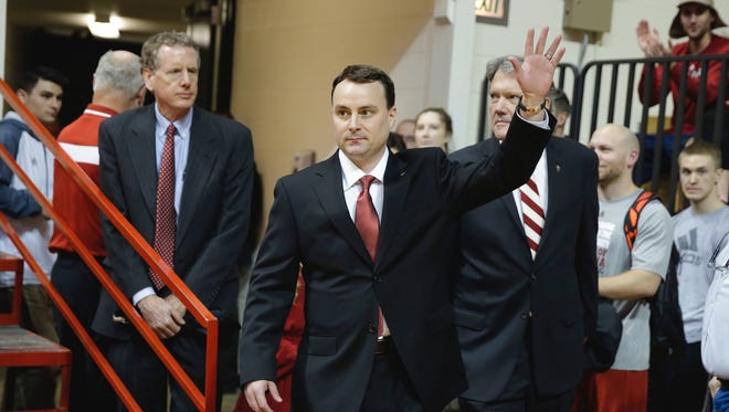 Archie Miller waves as he walks on to the court of Assembly Hall before he was introduced during a news conference on the court.