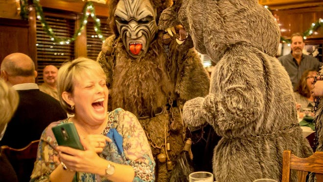 Scott Wolter is dressed as Krampus and Stefan Brunn is dressed as the Bear during a Milwaukee Mullers performance this month at Kegel's Inn in Milwaukee.