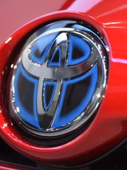 Toyota and Honda are increasing sales by targeting what's proven to be a sweet spot in the faltering market — demand for hybrid gasoline-electric cars.